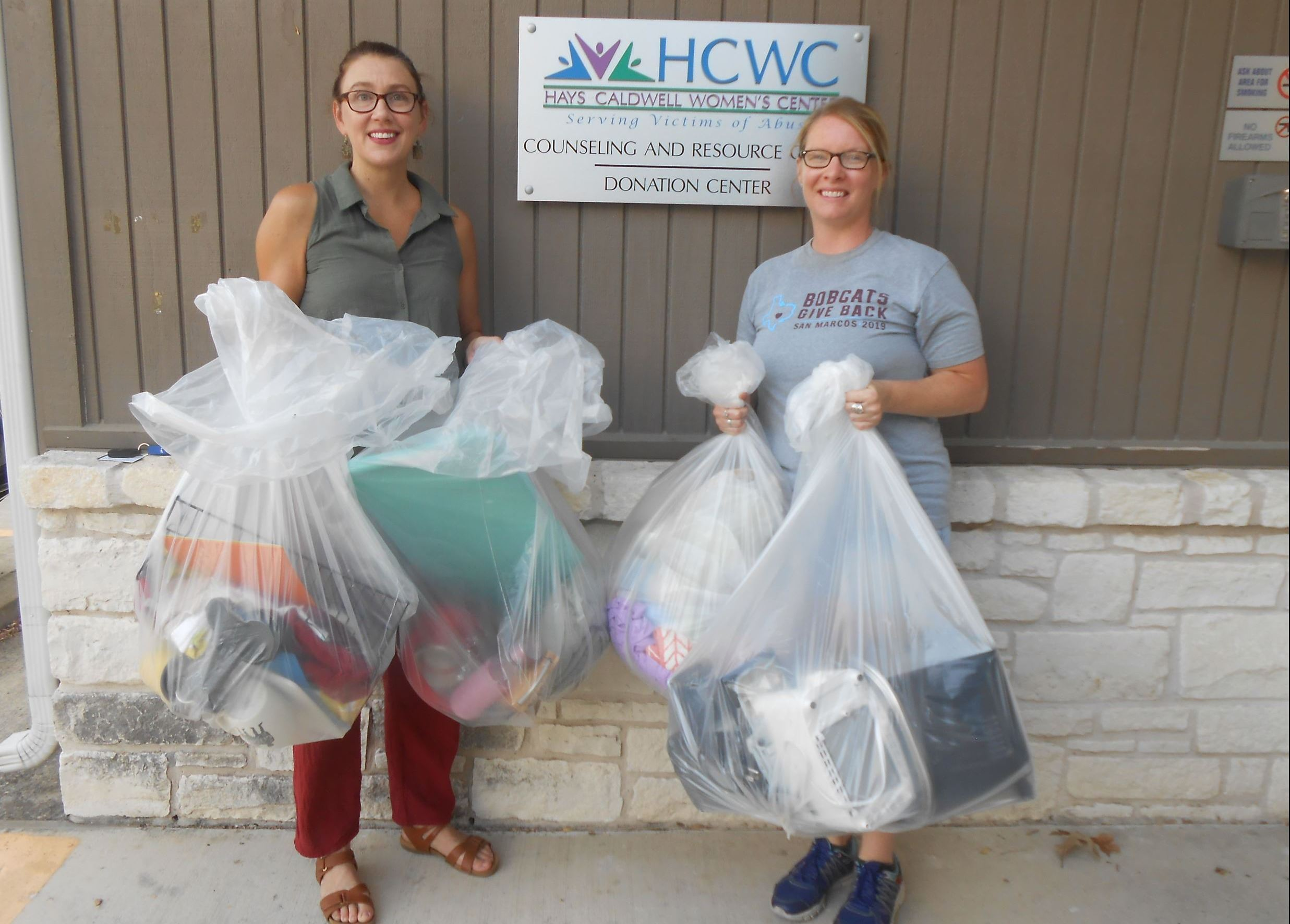 Photo of Bobcats Give Back volunteers delivering donations to Hays County Womens Center