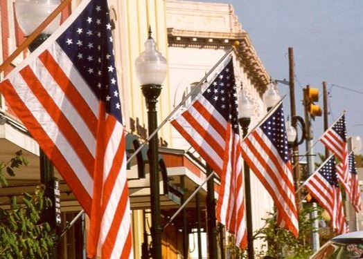 American Flags draped on buildings in downtown San Marcos