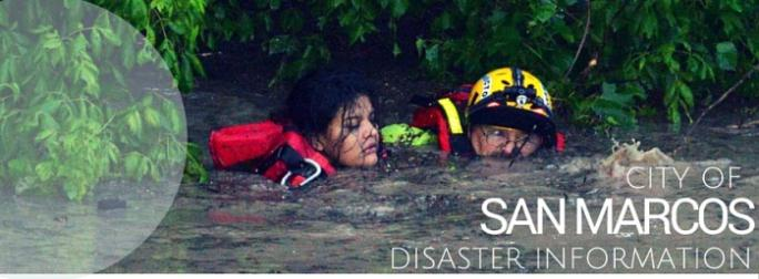 Man saving woman from flood waters
