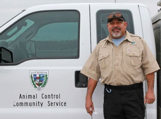 Baldo Patino standing in front of an animal protection vehicle
