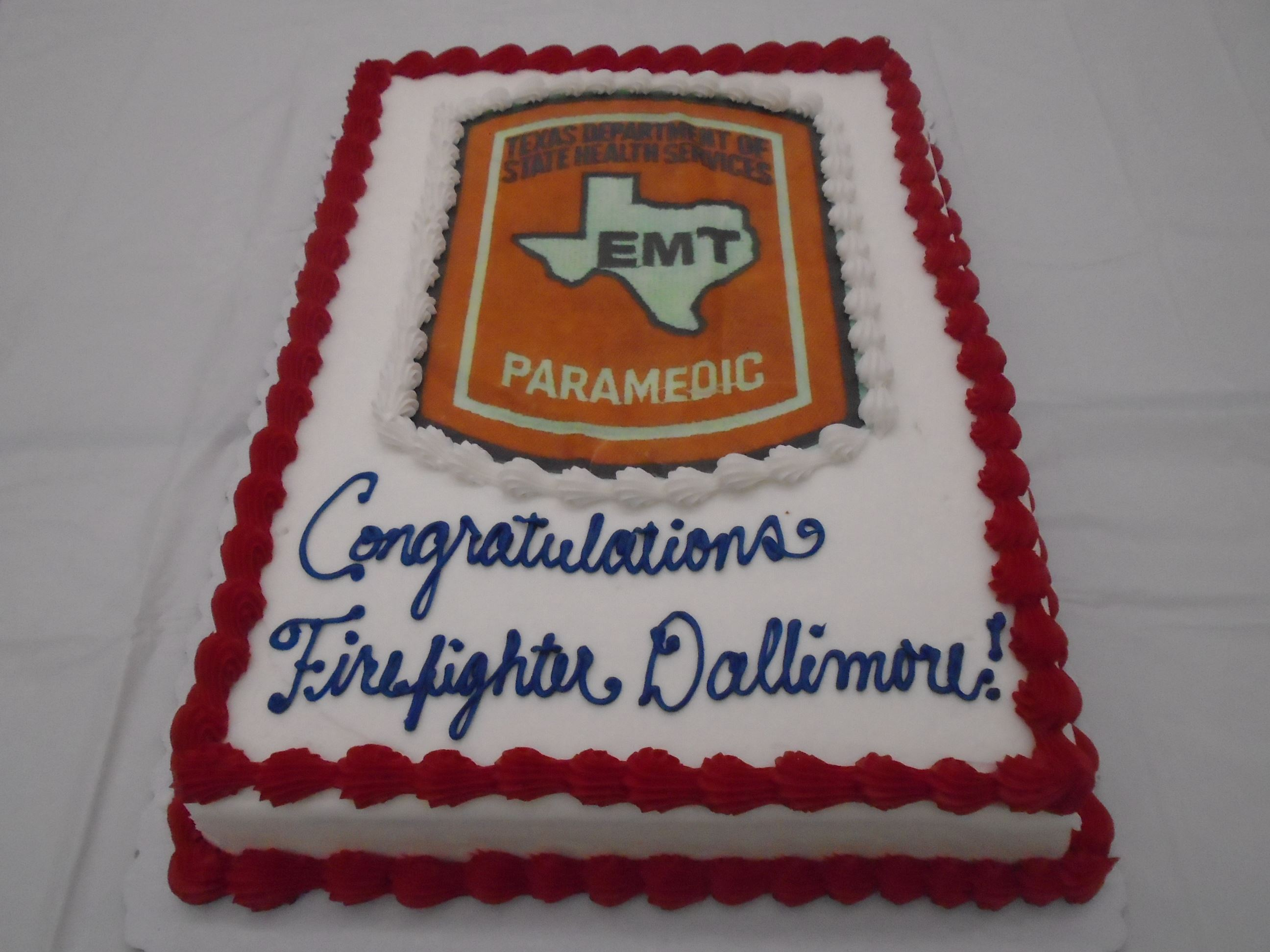 Custom cake ordered to celebrate firefighters paramedic certification.