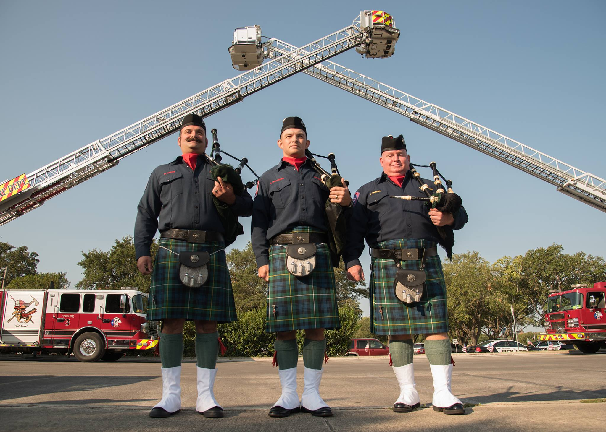 SMFD Bagpipers; Firefighters Micah Harris, Robert Dallimore, and Battalion Chief Jim Matano.